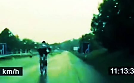 Cyclist escapes police on the highway going over 60MPH